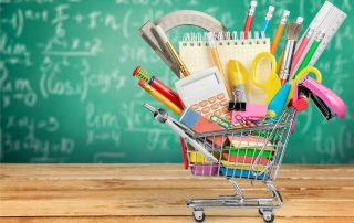 School supplies in shopping cart