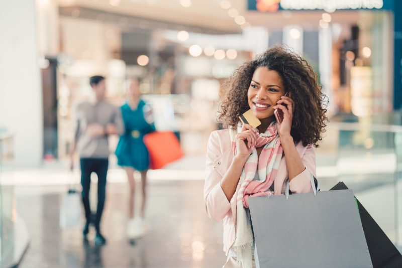 Woman shopping with credit card