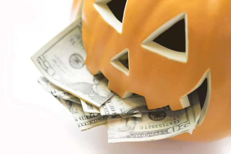 pumpkin with money in mouth
