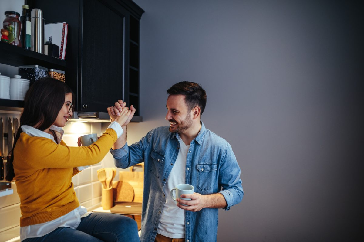 couple in the kitchen, giving a high five
