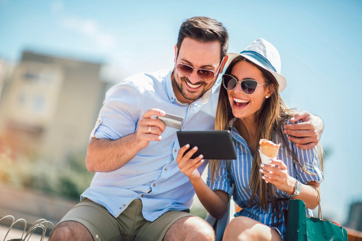 couple paying on line with credit card and digital tablet