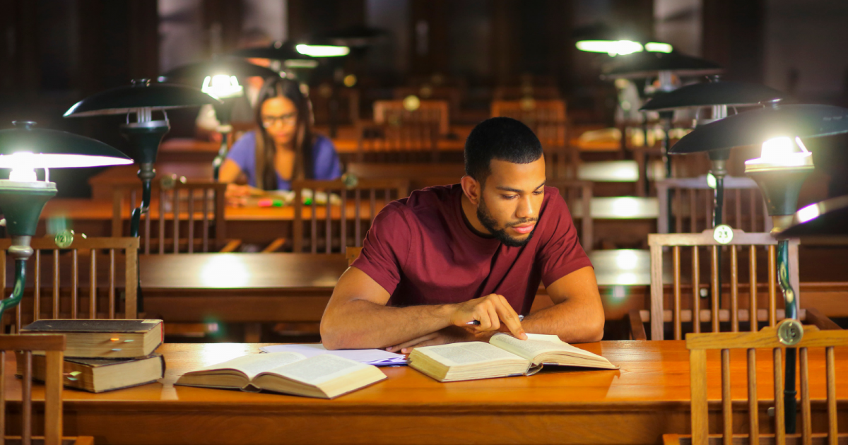 Man studying in library